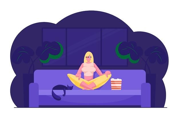 映画を見て、家でリラックスする女性