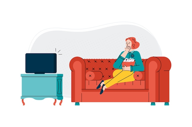 Woman watching television and eating popcorn at home