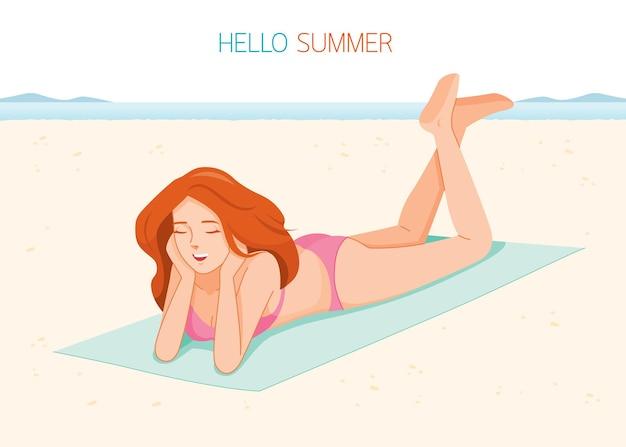 Woman wearing bikini lying on mat at beach