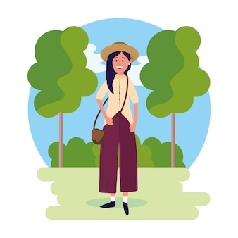 Woman wearing hat with bag and trees with bushes