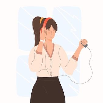 헤드폰을 끼고 음악을 듣는 여성