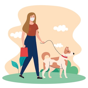 Woman wearing medical mask, walking with pet dog on the leash in outdoor