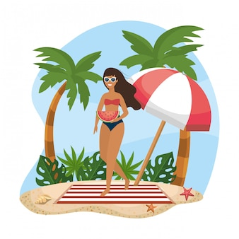 Woman wearing swimsuit and sunglasses with umbrella and towel