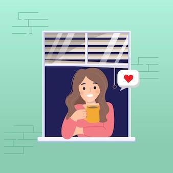 Женщина с бокалом кофе стоит у окна. оставайтесь дома концепции.