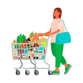 スーパーマーケットで食料品のカートを持つ女性。食べ物を買う。