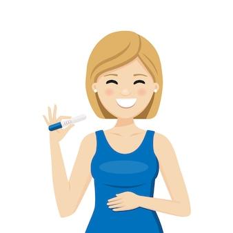 妊娠検査結果が陽性の女性。