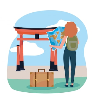Woman with backpack and global map to tokyo sculpture destination