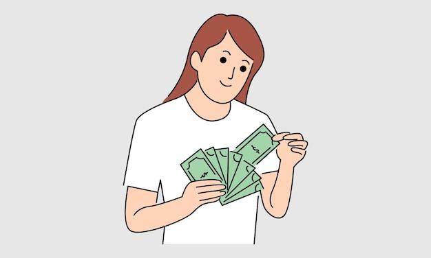 お金の紙幣を持つ女性