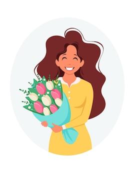 꽃의 꽃다발을 가진 여자