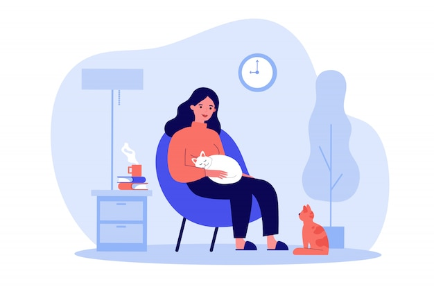 Woman with cats in cozy apartment