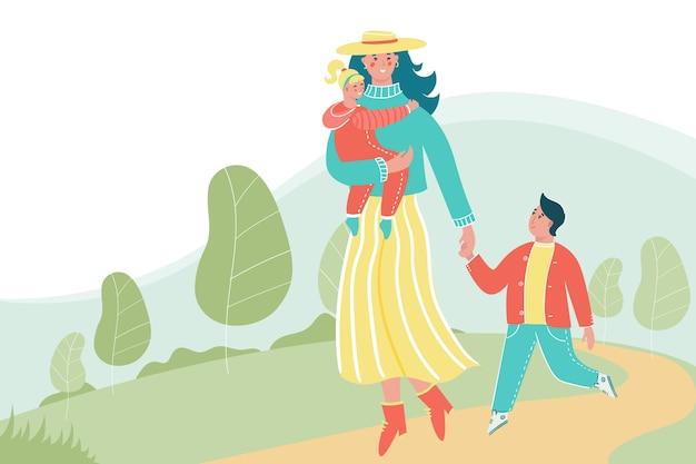 あなたのテキストのための場所で公園を歩いている子供を持つ女性。一緒に楽しんでいる子供たちと幸せな母。