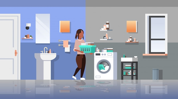 Woman with clothes basket near washing machine   housewife doing housework laundry room modern bathroom interior female cartoon character full length  horizontal