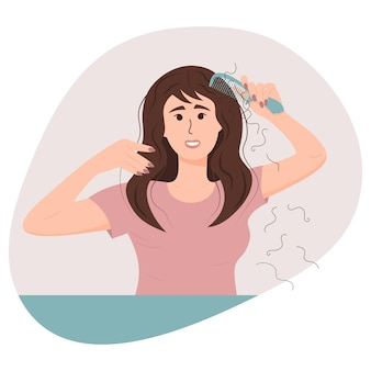 Woman with a comb suffering from the hair loss. alopecia in young age, hair problems, baldness.