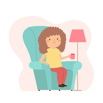 Woman with curly hair drinking a coffee at home