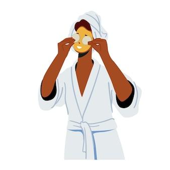 顔のマスクとキュウリの顔のスライスを持つ女性。女性キャラクターのスキンケアとトリートメント、スパ、ナチュラルビューティー
