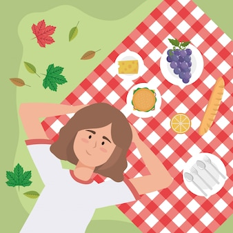 Woman with grapes and snack food in the tablecloth