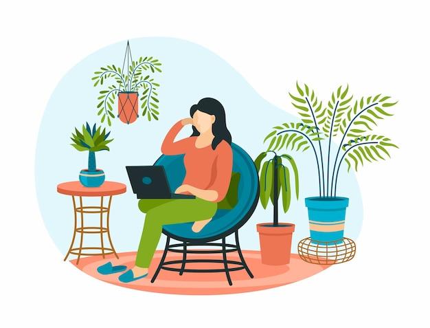 스칸디나비아 스타일의 안락의자에 노트북을 든 여성