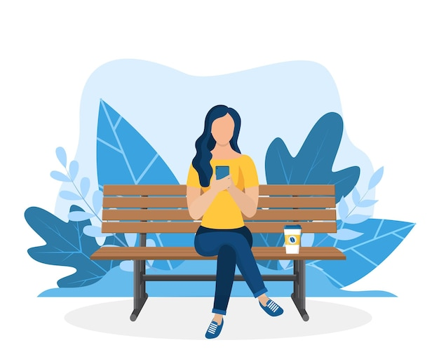 Woman with laptop sitting in nature