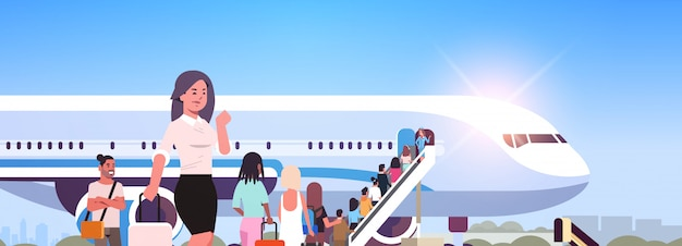 Woman with luggage standing line queue of people travelers going to plane rear view passengers climb the ladder to board aircraft boarding travel concept