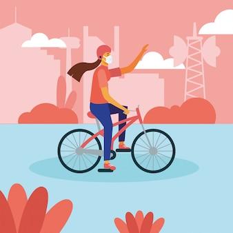 自転車の医療マスクを持つ女性