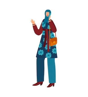 携帯電話、伝統的なヒジャーブの服を持つ女性