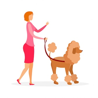 Woman with poodle on leash