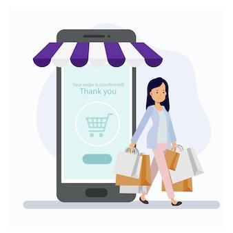 店から出て行く買い物袋を持つ女性、顧客とオンラインストアのコンセプトを買い物。