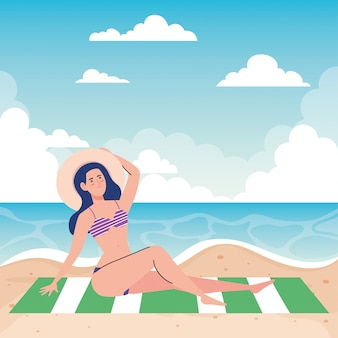 Woman with swimsuit sitting on the towel, in the beach, holiday vacation season