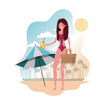 Woman with swimsuit and straw picnic