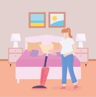 Женщина с пылесосом в спальне