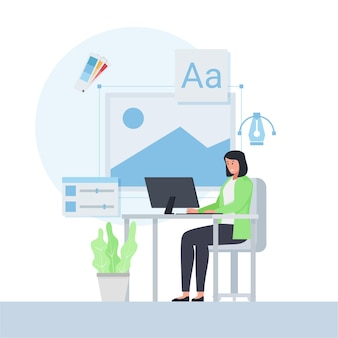周りのデザインアイコンと机の上で働く女性
