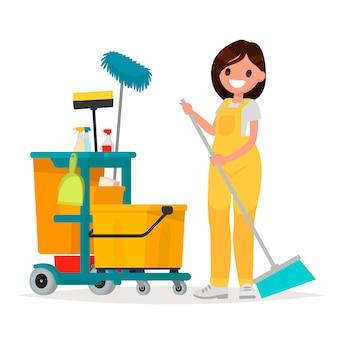 Работница службы уборки держит швабру. векторная иллюстрация в плоском стиле.