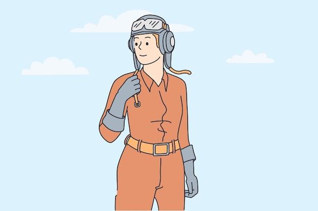 파일럿 컨셉으로 일하는 여성. 헬멧을 쓰고 보호복을 입은 젊은 웃는 여성이 자유와 자신감을 느끼며 멀리 바라보고 있습니다.
