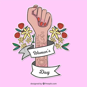 Womans day background with tattooed arm