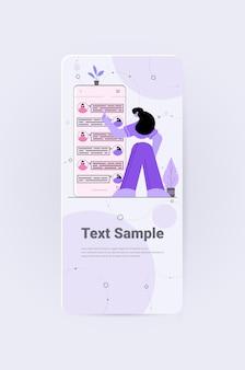 Women chatting in mobile messenger app social media network online communication concept vertical full length copy space