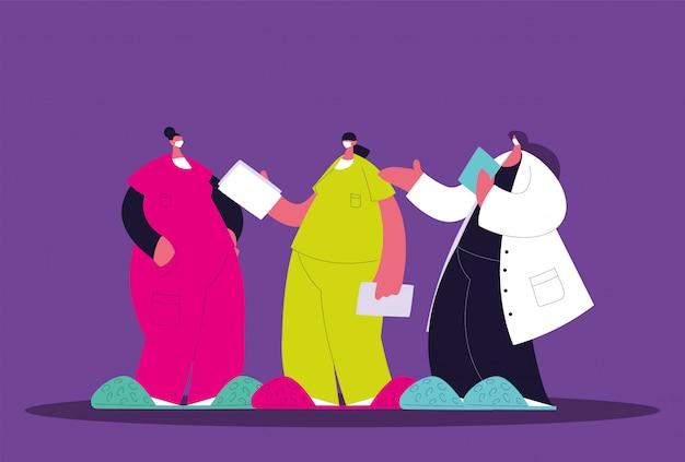 Женщины-врачи стоят, медицинская бригада