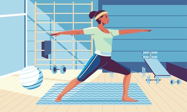 Женщины делают упражнения йоги в тренажерном зале с тренажерами