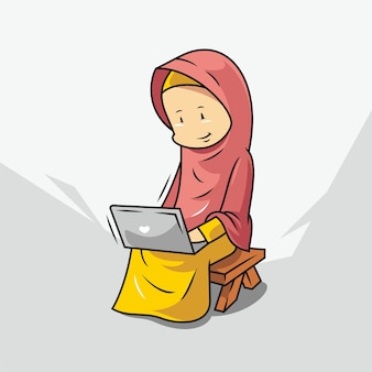 Women in hijab work on laptops