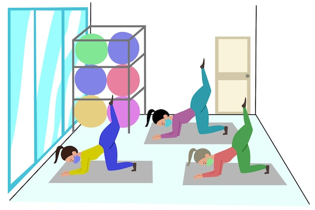 Women is group training in pilates gym during the pandemic girls do exercises in medical masks