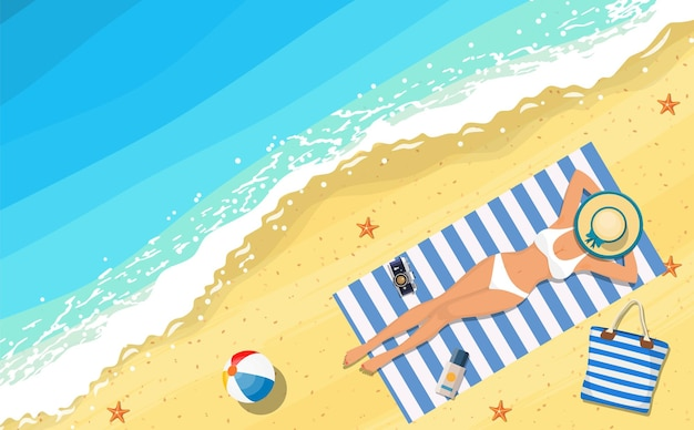Women lying on beach and sunbathing with summer accessories and sea surf near them.
