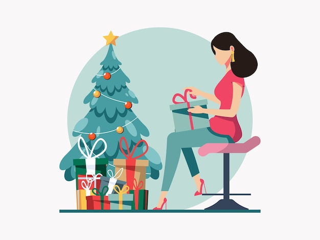 クリスマスツリーの横にプレゼントボックスを開く女性。