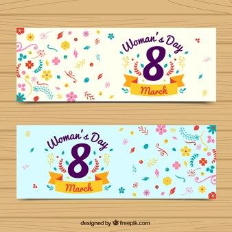Bandiere di giorno delle donne con fiori colorati a forma piatta