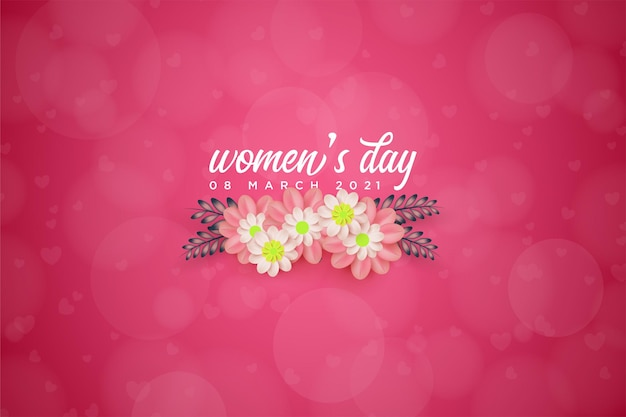 Women's day with flowers under the writing.