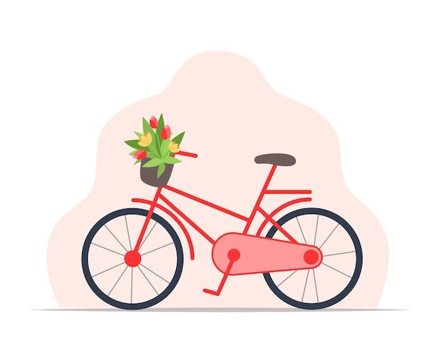 꽃바구니가 달린 여성용 빨간 자전거