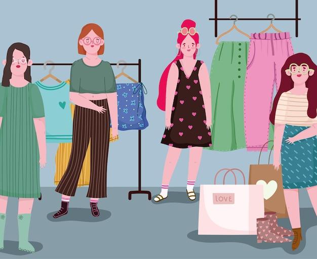 Женщины, делающие покупки модной одежды