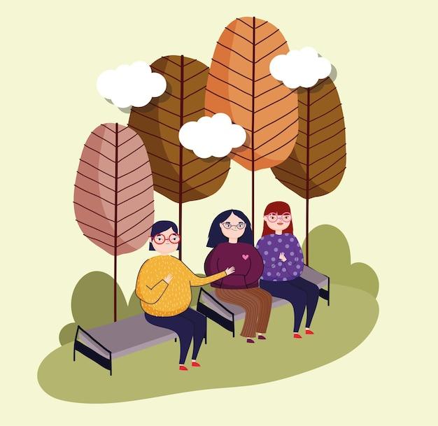 Женщины, сидящие на скамейке
