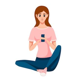 床に座ってスマートフォンを使用する女性