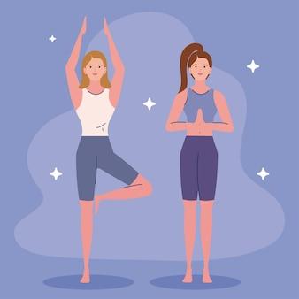 Women standing practicing yoga
