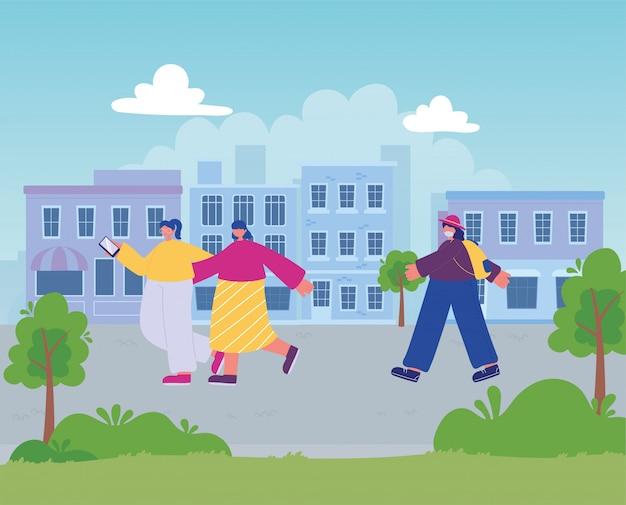 スマートフォンで街の通りを歩く女性とバッグを持つ女性