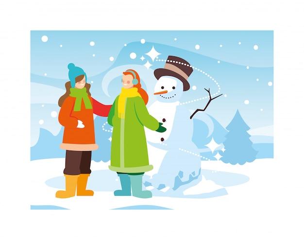 Women with snowman in winter landscape